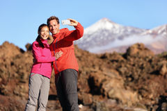 Couple taking selfie hiking in beautiful nature Royalty Free Stock Image
