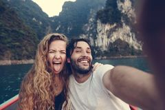 Couple taking selfie on a longtail boat stock images