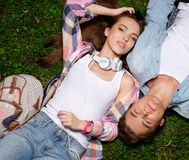 Couple taking selfie lying in a park Stock Photos