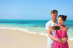 Couple Taking Selfie On Mobile Phone At Beach Stock Image