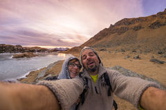 Couple taking selfie in the mountains by fisheye lens Stock Images