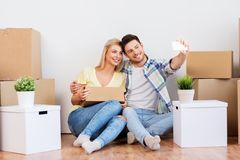 Couple taking selfie and moving to new home stock images