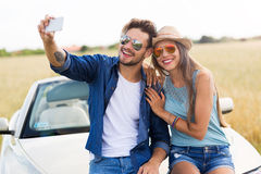 Couple taking a selfie while out on a road trip Stock Photo