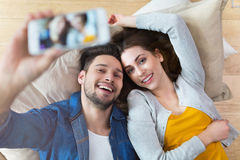 Couple taking selfie with phone Stock Photo