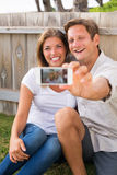 Couple taking selfie with phone Stock Images