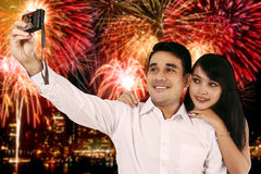Couple taking selfie photo with the fireworks background Stock Photos