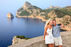 Couple taking selfie photo on Formentor Mallorca. Couple taking selfie photo with smartphone on Cap de Formentor on Mallorca. Young couple on Majorca vacation royalty free stock photos