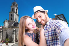 Couple taking a selfie photo in Havana, Cuba (San Francisco Square) Stock Images