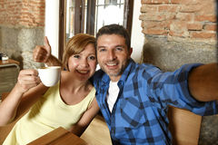 Couple taking selfie photo with mobile phone at coffee shop smiling happy in romance love concept Royalty Free Stock Photography