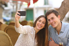 Couple taking a selfie photo in a restaurant Royalty Free Stock Image