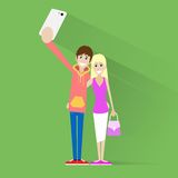 Couple taking selfie photo on smart phone over Royalty Free Stock Photography