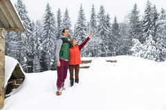 Couple Taking Selfie Photo On Smart Phone Snowy Village Wooden Country House Man Woman Winter Snow. Resort Cottage Royalty Free Stock Photos
