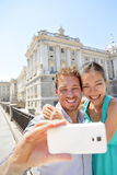 Couple taking selfie photo on smartphone in Madrid Stock Photo
