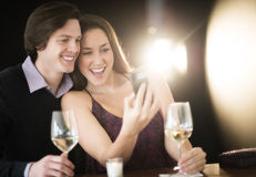 Couple Taking Selfie Through Smart Phone At Nightclub Stock Photo