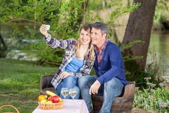 Couple Taking Selfie With Smartphone At Campsite Royalty Free Stock Photo