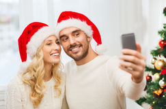 Couple taking selfie with smartphone at christmas Royalty Free Stock Image