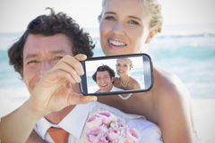 Couple taking selfie on smartphone Royalty Free Stock Photo