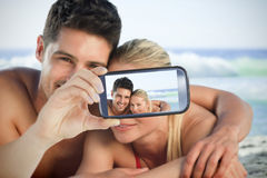 Couple taking selfie on smartphone Stock Photos