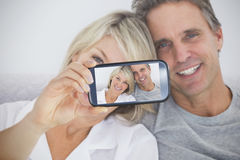 Couple taking selfie on smartphone Stock Image