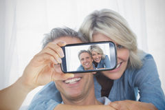 Couple taking selfie on smartphone Royalty Free Stock Photography