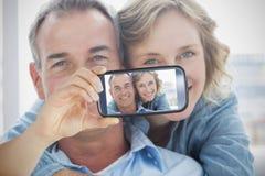 Couple taking selfie on smartphone Stock Image