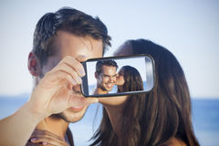 Couple taking selfie on smartphone Royalty Free Stock Images