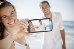 Couple taking selfie on smartphone Stock Photography