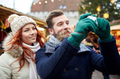 Couple taking selfie with smartphone in old town Stock Photography