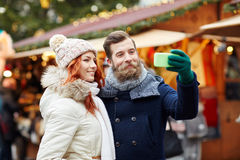 Couple taking selfie with smartphone in old town royalty free stock images