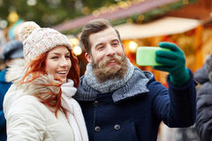 Couple taking selfie with smartphone in old town Stock Images