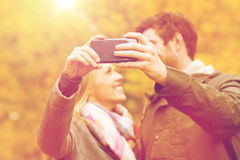 Couple taking selfie with smartphone in park Royalty Free Stock Photos