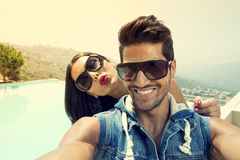 Couple taking Selfie with a smartphone Royalty Free Stock Image