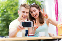 Couple taking selfie with smartphone Stock Photo