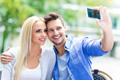 Couple taking a selfie with smartphone Royalty Free Stock Photography