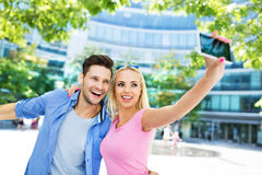 Couple taking a selfie with smartphone Royalty Free Stock Photo