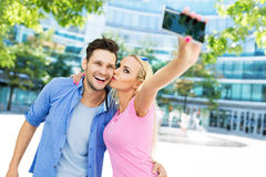Couple taking a selfie with smartphone Royalty Free Stock Photos