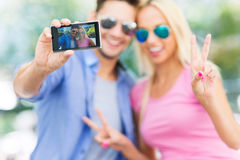 Couple taking a selfie with smartphone Stock Photo