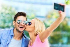 Couple taking a selfie with smartphone Stock Images