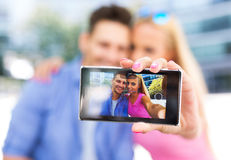Couple taking a selfie with smartphone Royalty Free Stock Images