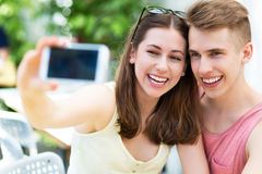 Couple taking selfie with smartphone Stock Images