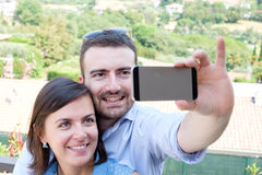 Couple taking  selfie Royalty Free Stock Images
