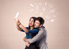 Couple taking selfie with thoughts illustrated Stock Photos