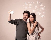 Couple taking selfie with thoughts illustrated Royalty Free Stock Image