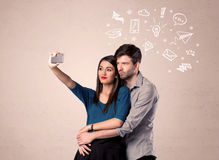 Couple taking selfie with thoughts illustrated Stock Photo