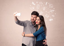 Couple taking selfie with thoughts illustrated Stock Photography