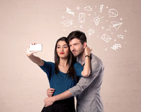 Couple taking selfie with thoughts illustrated Stock Image