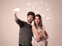 Couple taking selfie with thoughts illustrated Royalty Free Stock Photos