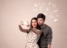Couple taking selfie with thoughts illustrated Royalty Free Stock Photography
