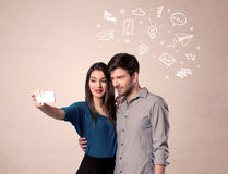 Couple taking selfie with thoughts illustrated Royalty Free Stock Photo