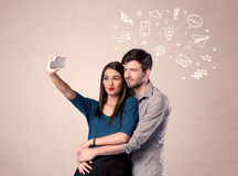 Couple taking selfie with thoughts illustrated Stock Images
